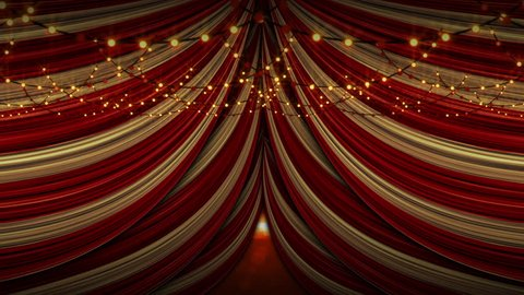 Red and yellow draped tent ceiling with round warm flashing fairy lights