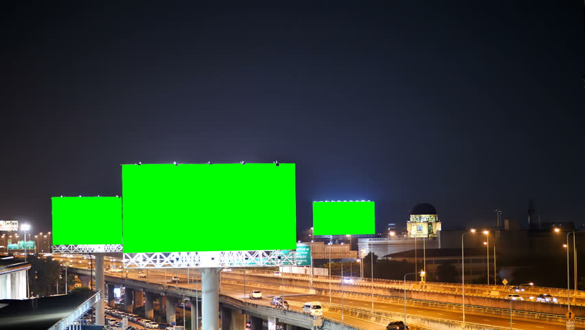 Green screen of advertising billboard on expressway during the twilight with city background in Bangkok, Thailand. #1019719291