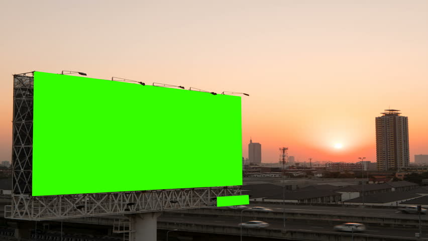 Green screen of advertising billboard on expressway during the sunset with city background in Bangkok, Thailand. Time lapse.  #1019719321