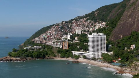 Aerial view of Rio de Janeiro, Brazil, showing favela Vidigal and Two Brothers mountain on a sunny day.