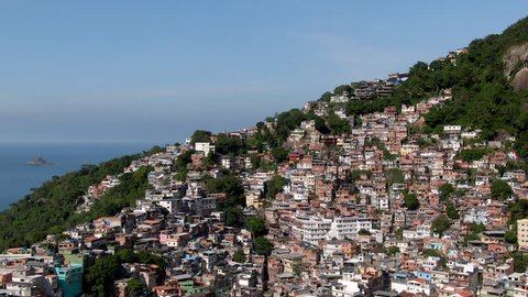 Rio de Janeiro, Brazil, aerial view, flying over favela Vidigal and Two Brothers mountain on a sunny day.