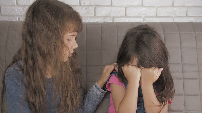 The child is crying. Older sister pities her younger sister. | Shutterstock HD Video #1019878381