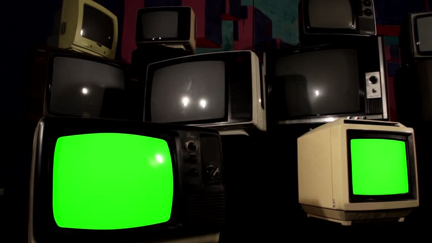 """Three Retro TVs Green Screen over a Pile of 80s TVs.  You can Replace Green Screen with the Footage or Picture you Want with """"Keying"""" effect in After Effects (check out tutorials on YouTube).   