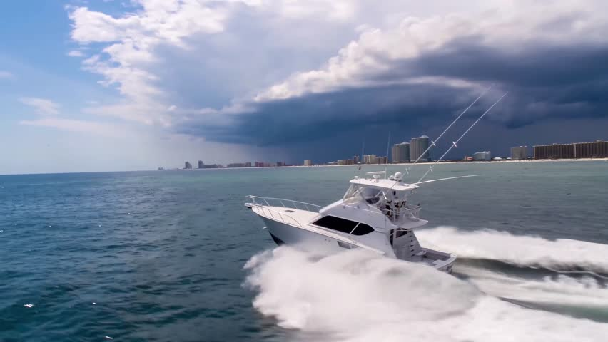 Drone aerial video of yachts and fishing boats off the coast of the Gulf of Mexico at sunset #1020014431