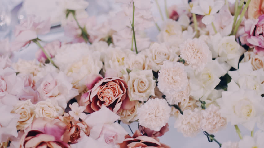 Passing by close up shot of beautiful asters, roses and andreanums in wedding bouquet. 50mm wide open lens. | Shutterstock HD Video #1020086641