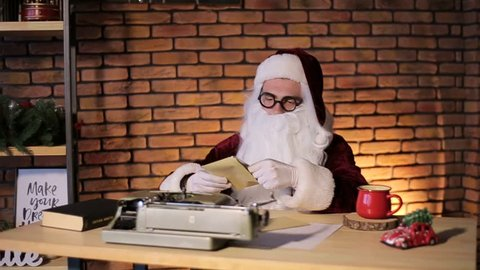 Mr. Santa Claus reading the kids' mail, Santa Claus reads postcards, wishes of children for the new year, Santa performs children's dreams