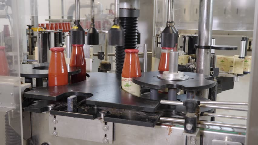portarit of Automated machinery in Tomato sauce Factory. Bottles,machine,technology #1020153751