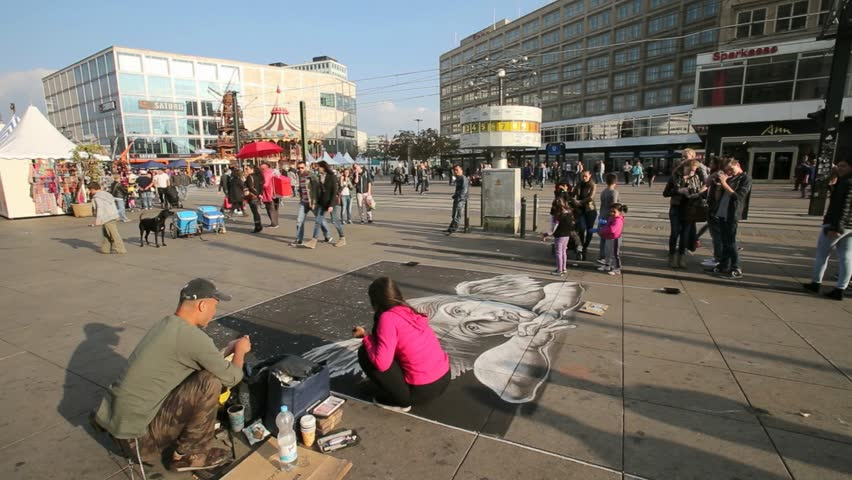 Berlin/Germany-2018: Street art- Chalk drawings on sidewalk at Alexanderplatz