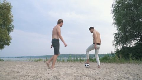 Two teenagers playing football Competition between people Friends have a fun together Spending time outdoors Active lifestyle