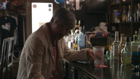 Image result for man sitting at bar with empty bottle