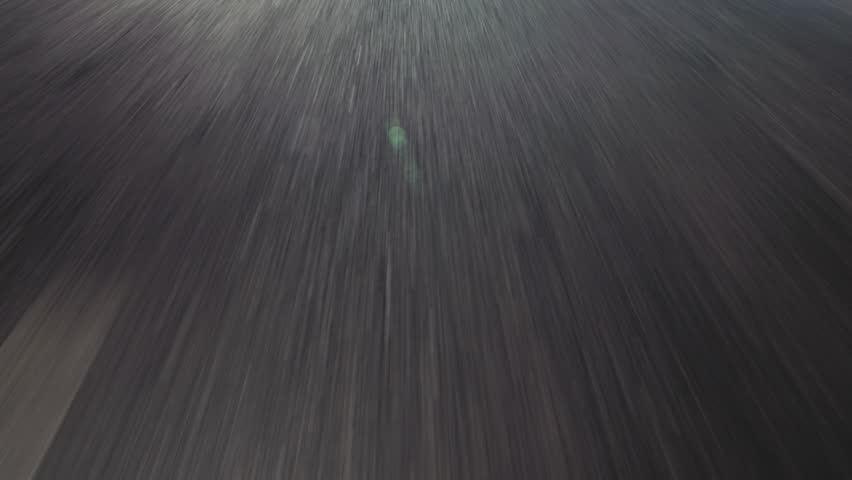 Moving Asphalt. Car Point of View (POV). point of view of a speeding car over asphalt. 4k footage