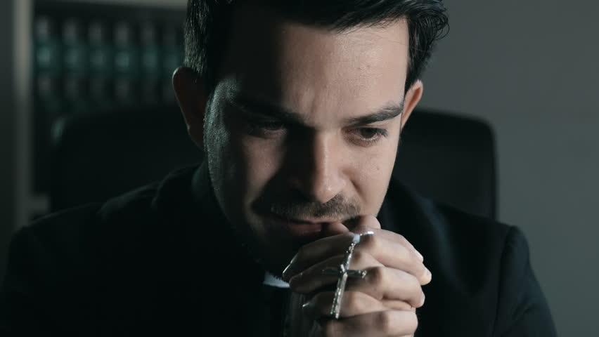 catholic priest is crying while praying with rosary: faith, prayer, God