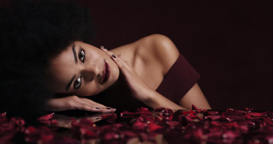 Portrait Beautiful African American Sexy Woman Relaxing Rose Petals Falling On Soft Skin Sensual Female Dreaming Of Intimate Fantasy Romance Indulging