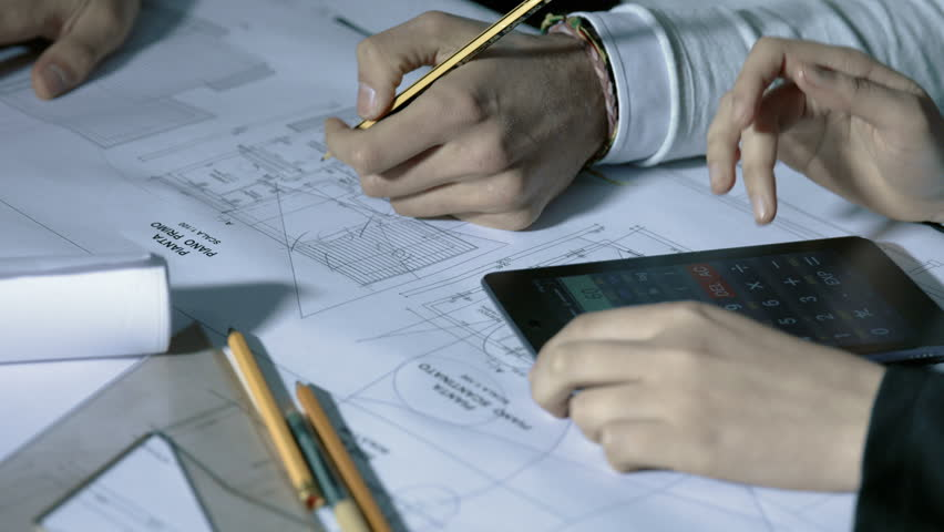 Team of architect working on blueprint with square ruler and team of architect working on blueprint with square ruler and calculator 4k stock video clip malvernweather Images