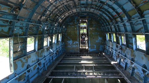 Inside of wreck of Douglas C-47. Old Abandoned plane at Yugoslav Air Base Zeljava on the Croatian-Bosnian border. Yugoslavia's largest and secret underground airport.  Zeljava Underground Airbase