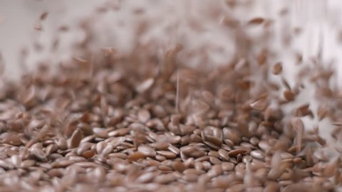 Lin seeds and rice falling slow motion