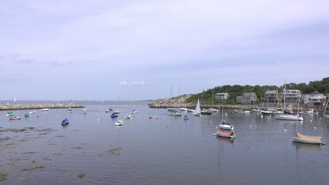 ROCKPORT, MA - SEPTEMBER 1: Summer day with Canoes in water at Rockport, Massachusetts on September 1, 2018.