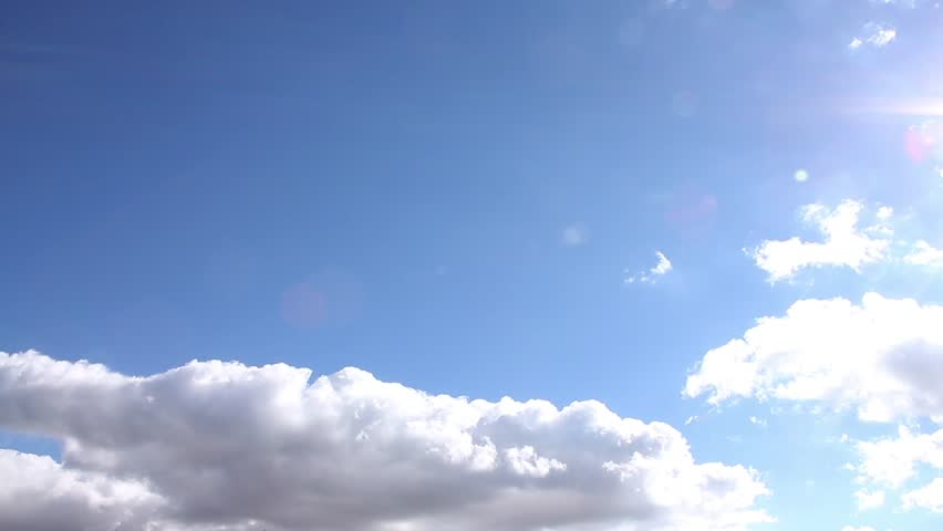 Clear blue sky, time lapse white clouds, beautiful summer sunny day, rolling cloudscape in horizon, real sunny shine, fast moving away, colourful footage. #1020554731