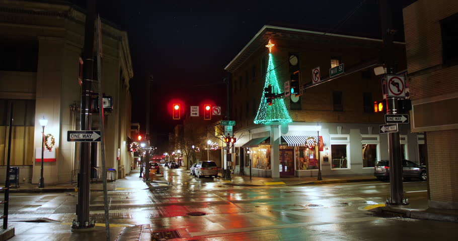 A nighttime establishing shot of a typical street corner in the business district of a small town in America during Christmas season. Pittsburgh suburbs.  	 | Shutterstock HD Video #1020589171