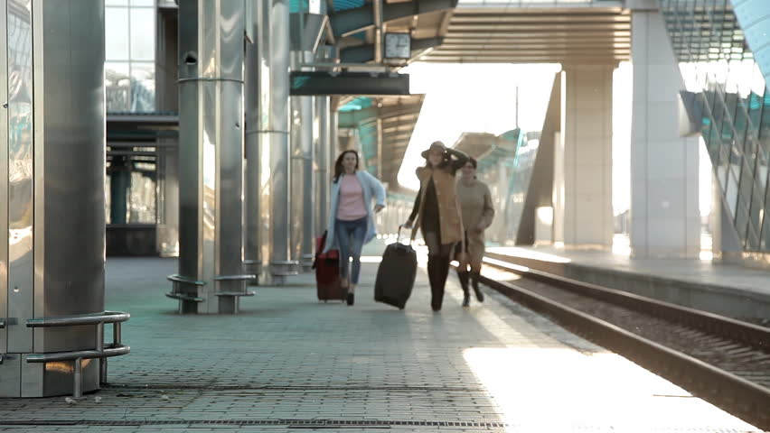 Railway station. three women running with Luggage running on the platform in a hurry on the train | Shutterstock HD Video #1020649501