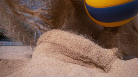SLOW MOTION, CLOSE UP, DOF: Young Caucasian woman in a bikini dives into sand while trying to score a point during a beach volleyball tournament. Athletic woman on summer vacation playing volleyball.