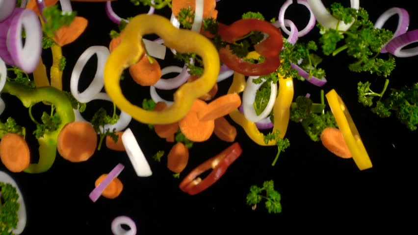 Falling slices of chopped vegetables isolated on black background, slow motion | Shutterstock HD Video #1020840961