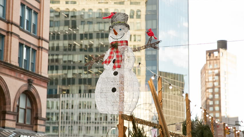 NEW YORK - NOV 29, 2018: Christmas snowman ornaments on Astor Place in NYC. Astor Place is a famous street that goes from Broadway to Cooper Square in Downtown Manhattan.