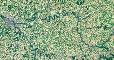 Very high-altitude overflight aerial of the Somme River, rural northern France. Clip loops and is reversible. Elements of this image furnished by NASA