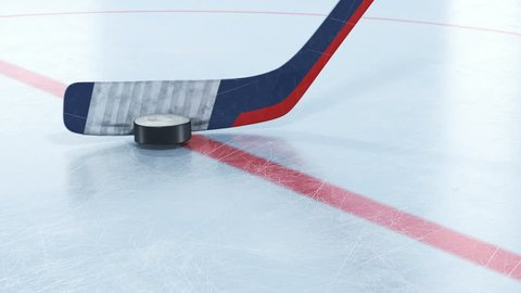 Hockey Stick Hitting Hockey Puck in Slow Motion Close-up on Ice. Beautiful 3d animation of Flying Puck. Active Sport Concept. ID Alpha Mask. 4k Ultra HD 3840x2160.