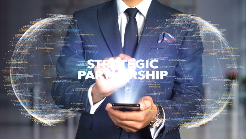 Businessman Hologram Concept Tech - STRATEGIC PARTNERSHIP   Shutterstock HD Video #1020896671
