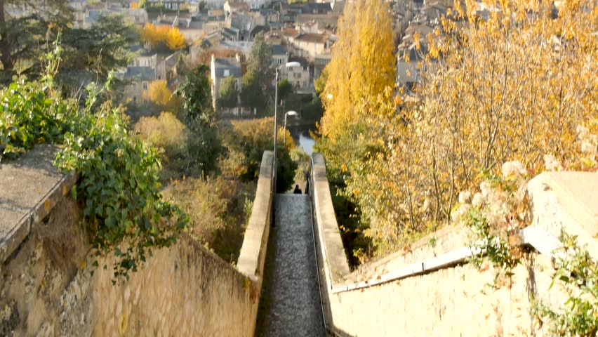 View of the city of Poitiers in the Vienne department, France. Camera movement. It starts with a view of the stairs and goes up to a panorama of the city in the background. Filmed during the fall. | Shutterstock HD Video #1020901171
