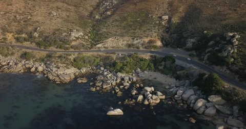4K aerial summer afternoon footage of spectacular Cozy Beach at Chapman's Peak Drive, Twelve Apostles mountains, Atlantic Ocean views near Hout Bay in Western Cape near Cape Town, South Africa