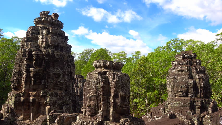 Faces of Bayon temple in Angkor Thom, Siemreap, Cambodia. The Bayon Temple (Prasat Bayon ) is a richly decorated Khmer temple at Angkor , ancient architecture in Cambodia #1021069981