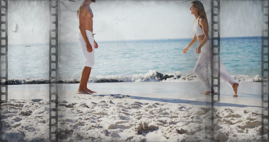 Old Movie tape showing couple at the beach jumping into each other arms | Shutterstock HD Video #1021104031
