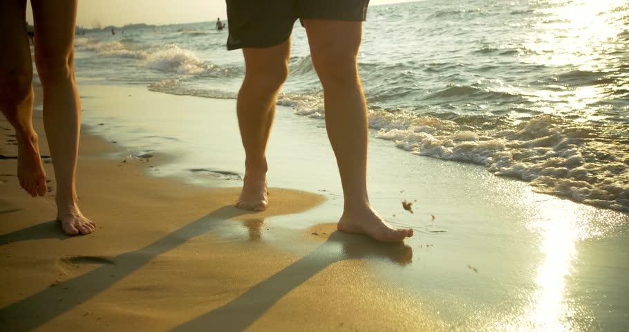 Couple Walks Barefoot on Beach | Shutterstock HD Video #1021165591
