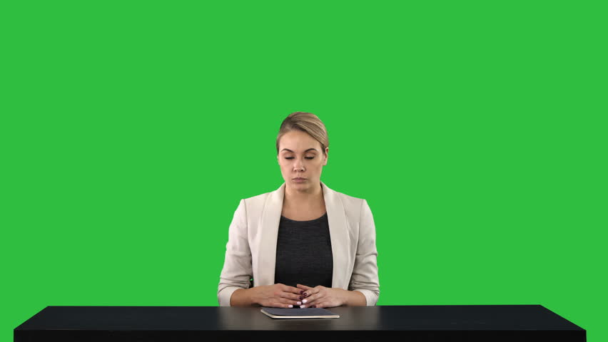 Television anchorwoman at studio pointing to sides on a Green Screen, Chroma Key. | Shutterstock HD Video #1021166761