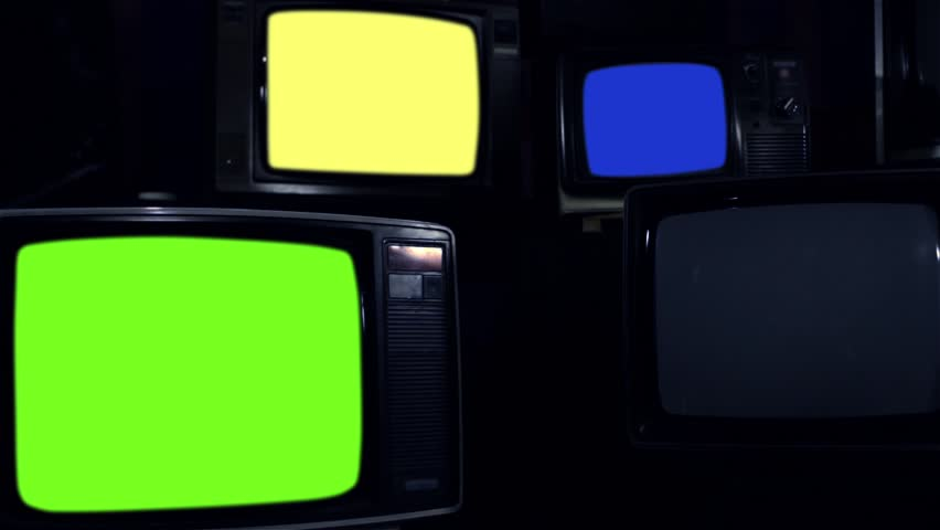 "Old Tvs Turning On Different Chroma Screen. Dark Tone.  Ready to Replace Chroma Screens with any Footage or Picture you Want. You can do it with ""Keying"" (Chroma Key) effect. 