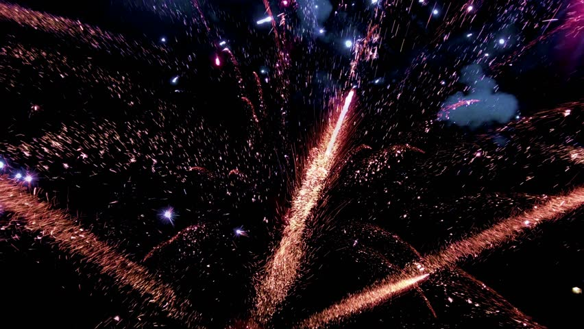 Abstract colored firework background, Celebration and anniversary concept. Fireworks in slow motion in night sky | Shutterstock HD Video #1021208161