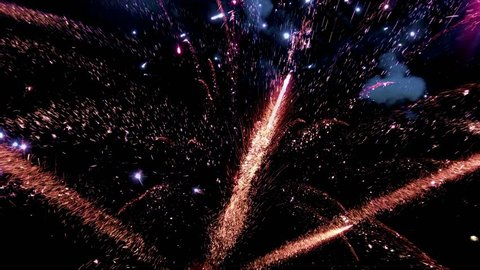 Abstract colored firework background, Celebration and anniversary concept. Fireworks in slow motion in night sky
