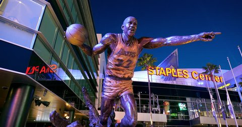 LOS ANGELES, CALIFORNIA - DECEMBER 9, 2018: Statue of the famous Lakers basketball player Kobe Bryant outside of Staples Center at L.A. Live in Los Angeles Downtown, California, 4K