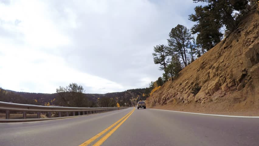 Driving on mountain highway 67 to Colorado Springs in Autumn. | Shutterstock HD Video #1021361401