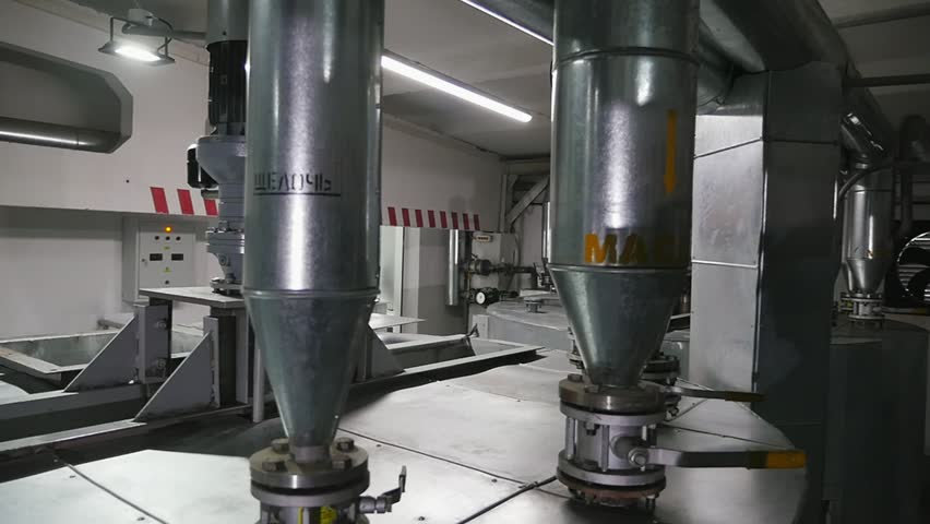 Panoramic shot of thin round tanks put on metallic machine device of oil factory #1021450681