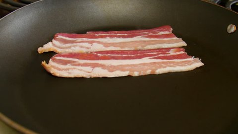 Cooking Strips of Bacon on the Stove