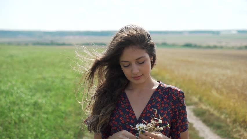 Portrait of young girl in summer field. | Shutterstock HD Video #1021492861