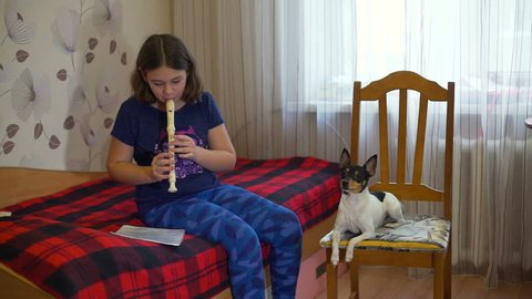 Girl Playing the Flute and the Dog is Howling