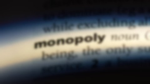 monopoly word in a dictionary. monopoly concept.