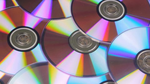 Bunch Of CD Discs Rotates Reflecting Light