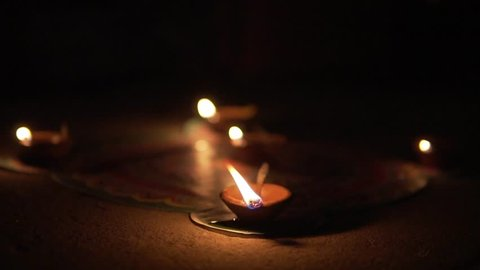 Traditional Indian lamps lit at night. Deepak Oil lamp. Diwali.