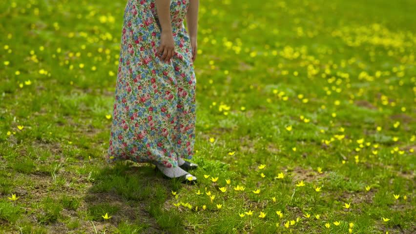 Woman in a Long Dress Collects Flowers | Shutterstock HD Video #10217081
