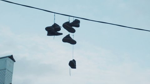 Six pairs of sneakers hanging on electric wires at a height of nine meters